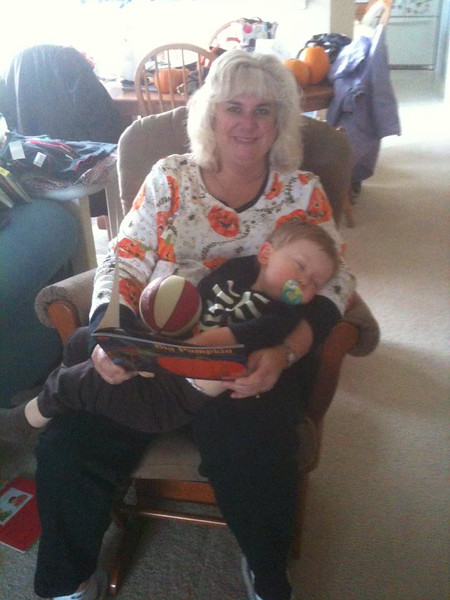 After his wonderful babysitter Sandy read countless Halloween books to him, he finally fell asleep for his nap, with Sandy Petrashevich Huesca and Stephen J Sullivan