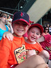 Zach and Evan having fun watching a game, 2014