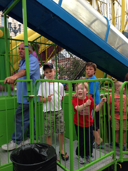 Having a great time riding rides & playing games  2014
