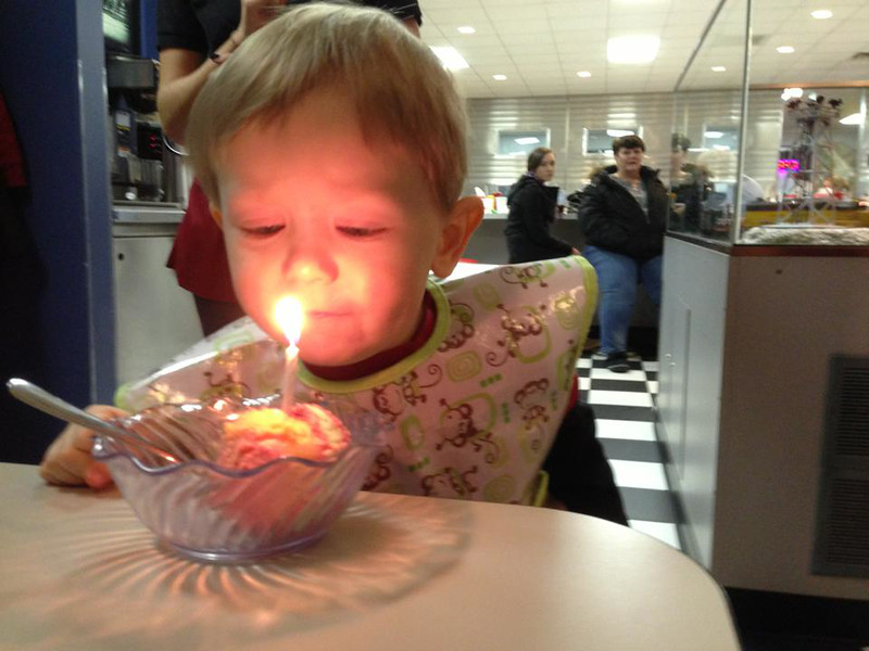 Blowing out his candle