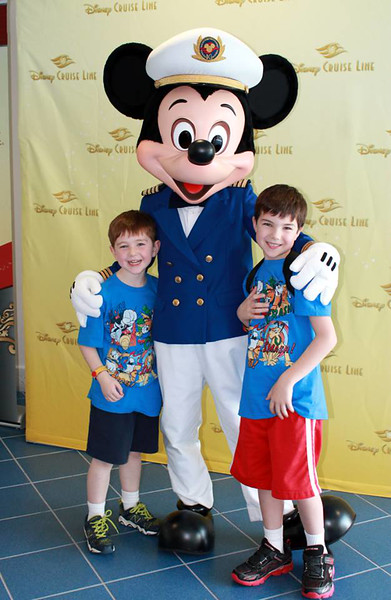 Waiting for our boarding number with Mickey