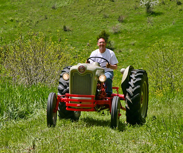 Dale Happy on Tractor