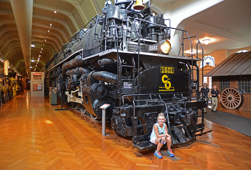 Angel sitting on the long black train....  One of the last steam locomotives built.  Quite an impressive sight.