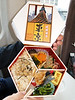 A bento box featuring Tokyo Tower and yummy foods