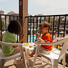 Izzie and Simon cracking up over snacks. They wanted a seat overlooking the swimming pool.