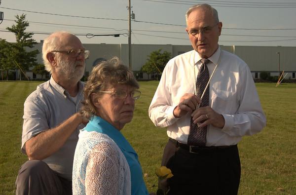 Wilson Kratz (pastor) with Mom & Dad, watching the proceedings