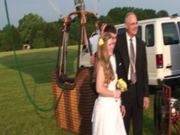 """""""Balloon Lift-Off"""" -  Video made by Rob Yoder, about the lift-off of the hot air balloon that will carry our daughter Trudy & fiance Bryan up in the air for their wedding! Music is """"Wet Rainy Day at the Faire"""" by Alf Bashore."""
