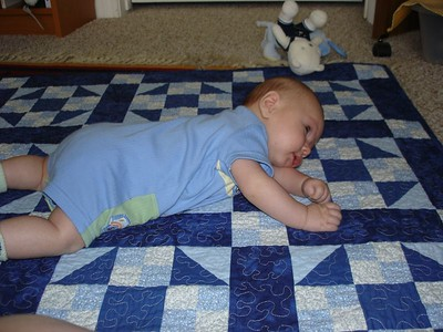 Tummy time day 2. I'm trying to roll onto my back.