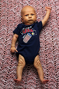 Respect the power of a USA baby!  Strobist: YN-460 in a 24 inch Westcott Apollo soft box boomed at 12 o'clock.