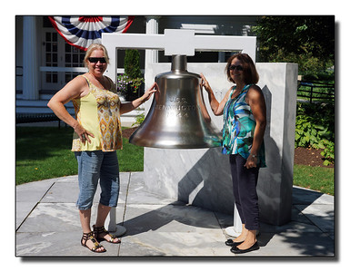 This is two of George's children, Gail & Susan posing with the ship's bell in Bennington, VT.