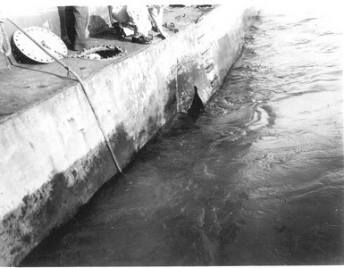 """Kamikaze (wind of god), that hit the ship in the """"blisters.""""  Blisters were the doubled hull part of the ship at the waterline designed for situations just like this."""