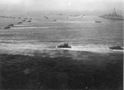 Bow of USS Idaho, supporting marines landing on an island.  Don't know which one this is but USS Idaho was in all the major battles, Saipan & Tinian, Iwo-Jima, Okinawa
