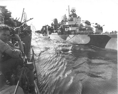 Transporting supplies to one of the four destroyers that always accompanied the USS Idaho.  What were they transporting from the Battleship to the destroyer?  Ice cream of course!  The battleship had an ice cream maker and the destroyers did not.