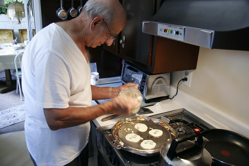 Uncle Toddy making his famous blueberry pancakes