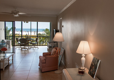 Entering through the front door, looking through the Living Room & Porch out to Siesta Beach Park.