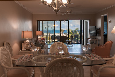 Looking from the Kitchen through the Dining Area, Living Room, and Porch out to Siesta Beach Park.