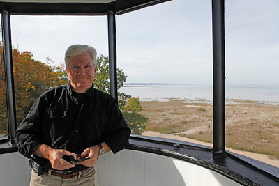"Bradley S. Pines is still ""Damn good-looking"" after all these years, says Joyce. Somehow Brad's phone lost its battery cover and got turned around while climbing onto the Old Mission Lighthouse cupola."