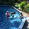 Scout jumped over the pool wall next to Christine and landed on the float- the dogs like floating with Barbara in the pool