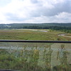 View from the visitor center looking straight down the flight path of Flight 93 toward the crash site (at the treeline in the distance).  The building on the left is at the Memorial Plaza.