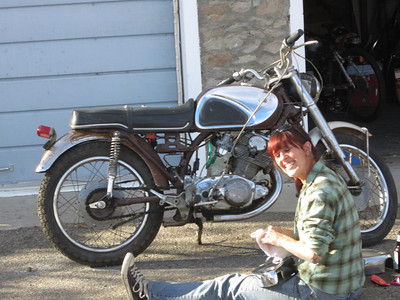 SMITTEN - Uncle Dennis visited with this motorcycle mechanic working on a 1960s-era Honda 305 - and he was smitten!