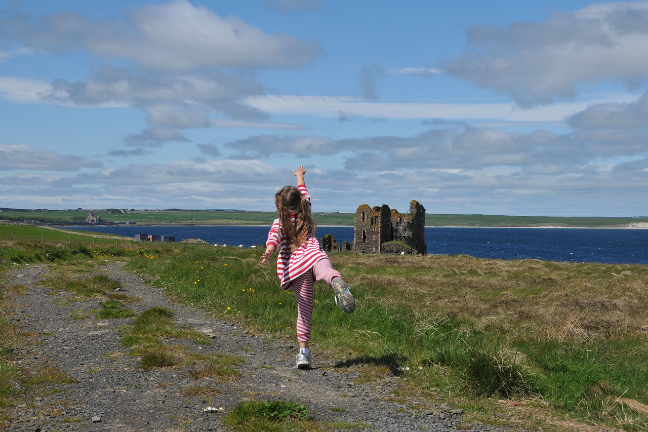 Alice is inspired to interpretive dance in front of the Castle Sinclair ruins.