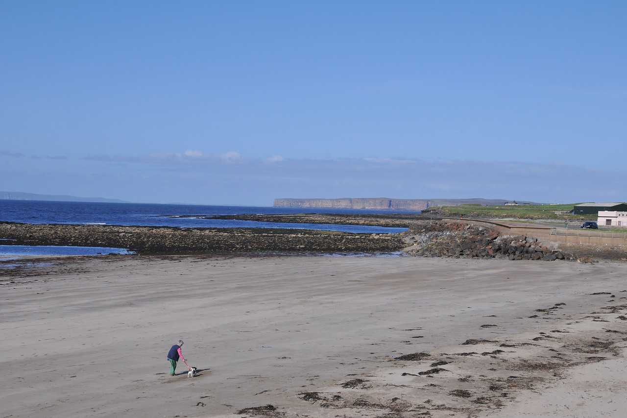 Thurso bay beach vista. Dunnet Head in the left background, island of Hoy on the distant left.