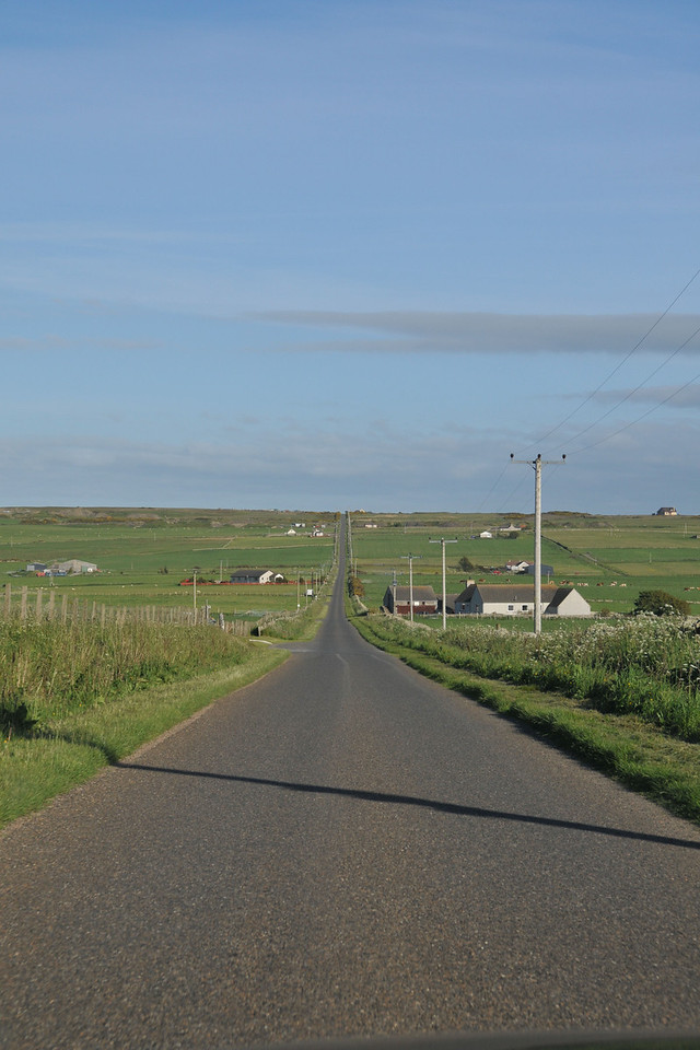 View of road from Thurso to our cottage, which is just over the rise on the right (you just see the roof). You can just see the quarry across the street on the left on the horizon.