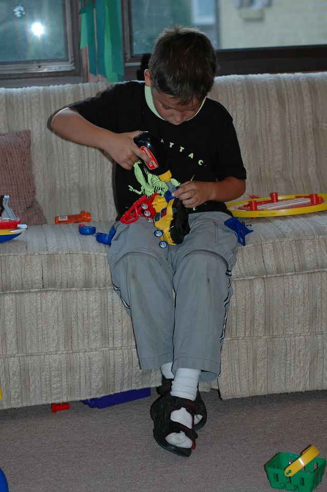 Corwin works on re-assembling the toy
