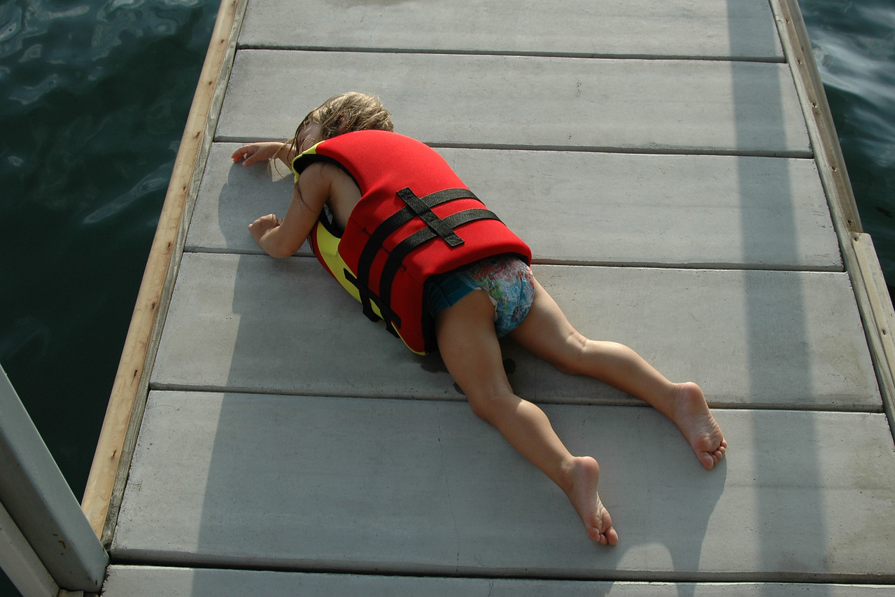 Alice passed out on the dock from a screaming fit. She wanted to swim by herself but Mom wouldn't let her.