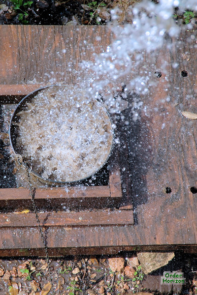 Cool falling water shot, because I could.<br /> This is Mimi's racoon watering station, below the deck.
