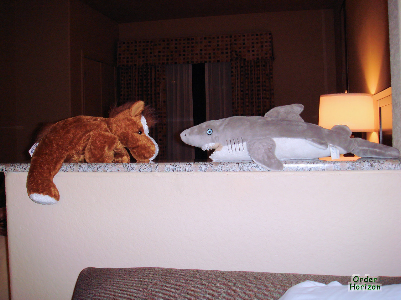 Charles and Alice insisted on having the stuffed animals sleep on the ledge in the hotel room