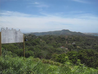 Center of the island of Roatan, Honduras and at close to the highest point by the Zoo.