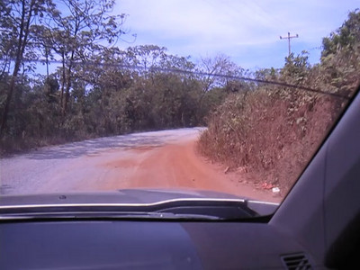 Roatan, Honduras.  With a our Nissan SUV rental (thankfully a manual transmission) we took the dirt road out to Paya Beach.  Miles of dirt/gravel road.  Our SUV shook the entire way.  these roads are car killers.