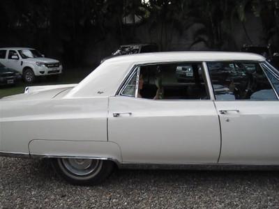 Alex & Edelweiss' Wedding Ceremony, San Pedro Sula, Honduras.  Edel arrives in an classic Cadillac.