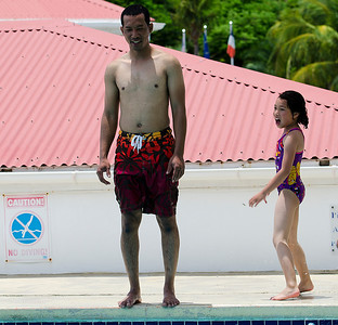 Cuong & his daughter, Jennifer, having fun at the pool