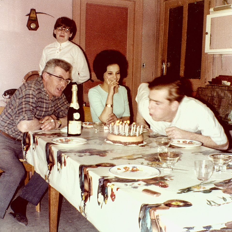 it appears that it is Marc's birthday.  Francoise watches Marc blow out the candles as his Father-in-law, Angelo, and sister-in-law, Marie Ange look on.  March 7, 1967?