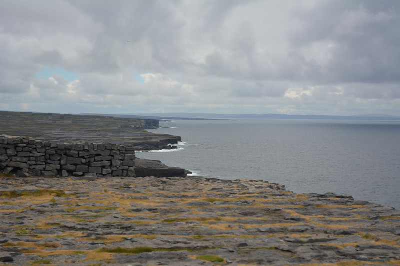 View down 100 ft. cliff at Dun Longhasa fortress, Inis Mor, Galway, Ireland.