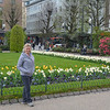Karen with tulips in a town square, Bergen, Norway.