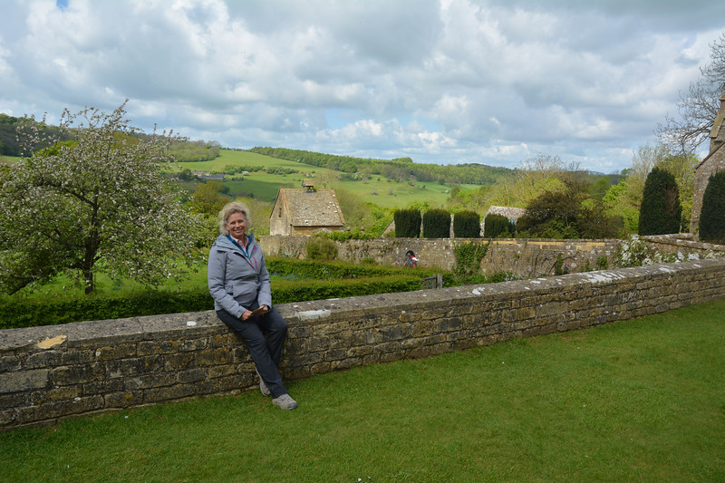Karen on wall, Snowshill Manor, The Cotswolds, England.