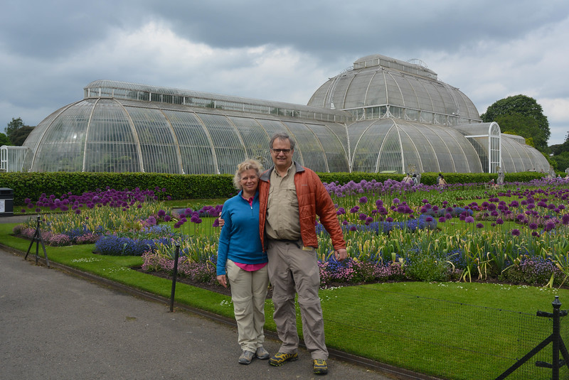 Karen and Vance by alliums and tropical greenhouse, Kew Gardens, London.