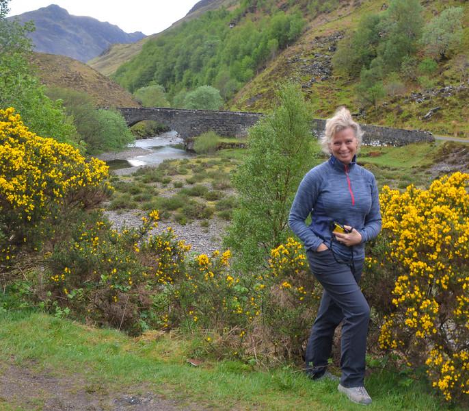 Karen near gorse bush in the Scottish Highlands.