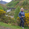 Karen near gorse bush in the Scottish Highlands.