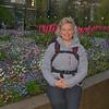 Karen in front of flower planter, Bergen, Norway.
