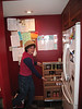 Juli showing off the cabinets.  They have lots of nice drawers and cabinets and nooks.  It's a well-laid-out kitchen.