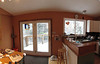 Dining room, patio doors (out onto the deck), and kitchen