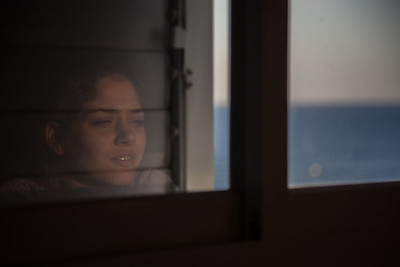 Reflection of Young woman's face in the window