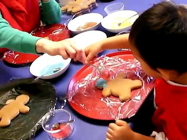 Christmas 2007..  Decorating those gingerbread men.