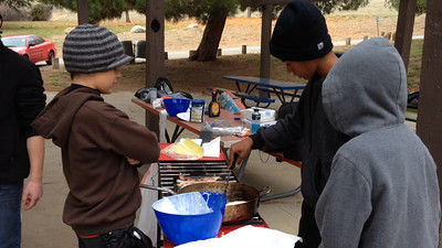 Scouts cooking on campout winter 2014.