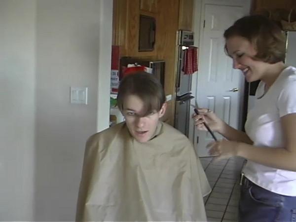 Liz cuts Don's ponytail