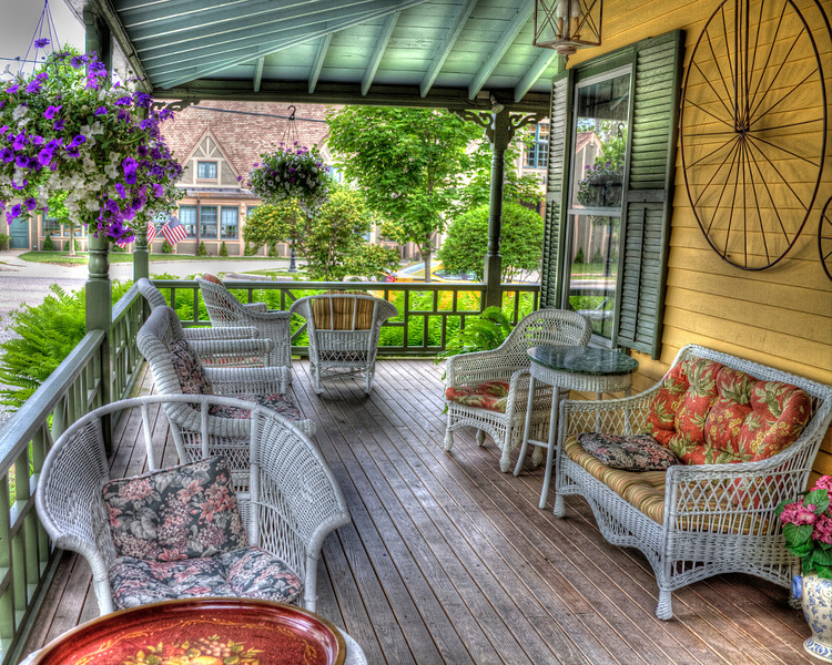 """Enjoying a porch in Bar Harbor, Maine<br /> That's """"Bah-Hah-Bah"""", to the locals. Each time we have visited Bar Harbor, we end up staying at the same B&B. We spent many hours on this porch in the evening, working on photos and the blog. We love the old fashion feel of just kicking back, enjoying the outdoor weather, with no T.V., no radio..ah except for the modern day vices..our laptap! I guess we could have gone without it, but that didn't sound like any fun."""